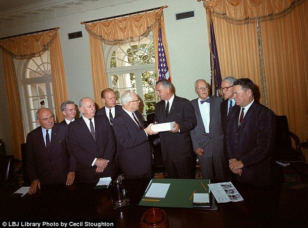 Commish: Supreme Court Chief Justice Earl Warren (fifth from left) hands the report from the Warren Commission's investigation into the death of President John F. Kennedy over to President Lyndon Johnson.