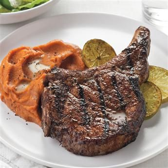 Cat Cora's jerk-marinated grilled pork chops are juicy and flavorful. Serve with roasted ginger-spiced whipped sweet potatoes. #recipe