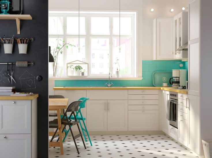 A white kitchen white LAXARBY doors, a KARLBY worktop in birch and green details