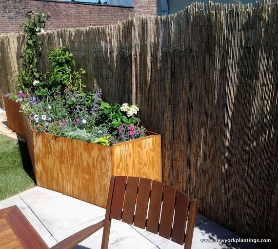 Then custom Planter Box with beautiful flowers made by New York Plantings. New York Plantings Garden Designers and Landscape contracting 432 E 14st  New York, NY 10009 Call: 347-558-7051    site url:   http://www.newyorkplantings.com/Home.php  info@newyorkplantings.com