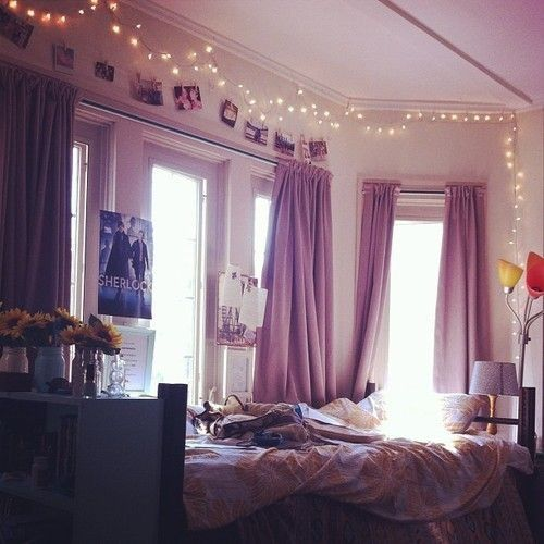 lights over curtain with pictures and clothes pins underneath