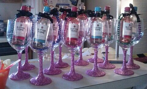 Wine glasses wirh glitter stems and mini wine bottle with black bows on a beaded necklace