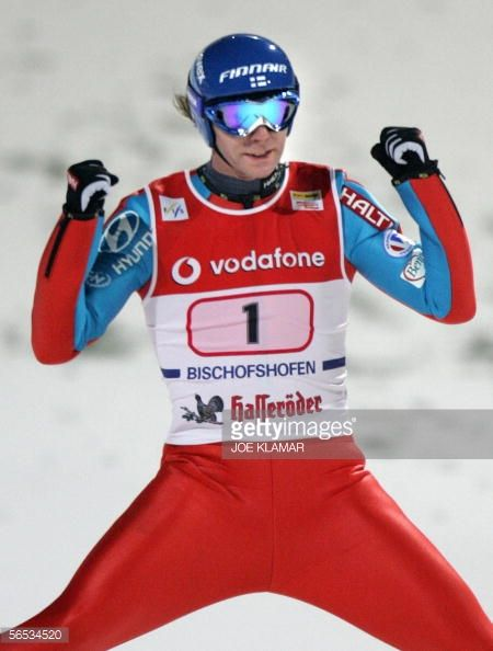 Janne Ahonen of Finland celebrates his victory as he lands at the final jump at FIS skijumping World cup the final round of the Four Hills Tournament...