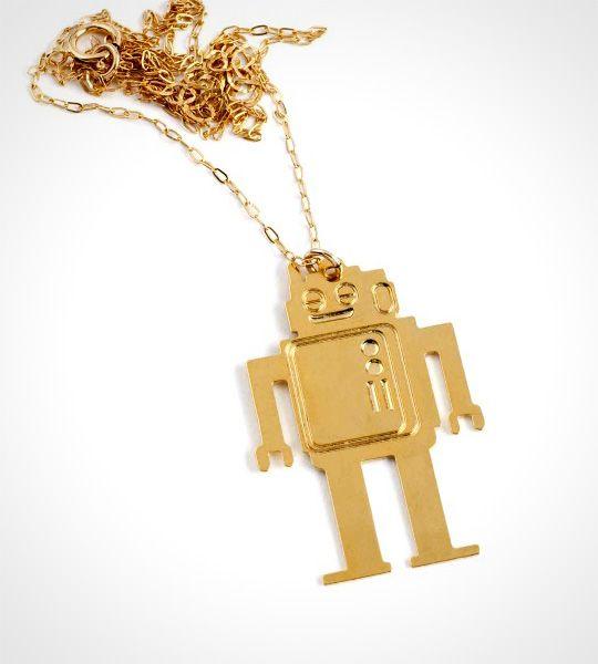 Funky Robot halskæde – Guld  Funky og opsigtsvækkende guldrobot til piger med humor og kant. Materialet er messing belagt med 24K guld. Robotten hænger i en fin forgyldt kæde.