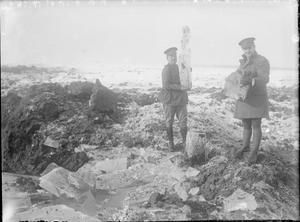 WWI, Dec 1916, Beaumont Hamel; British officers with chunks of ice broken up by shell fire. ©IWM