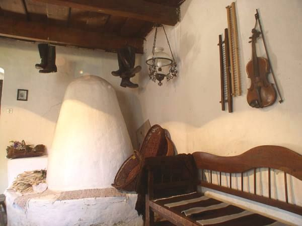 Traditional Hungarian beehive stove with bench in a living room