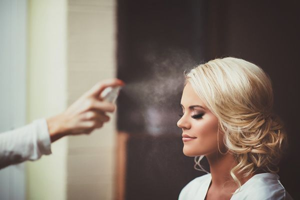 Surreal and pretty photo of the bride getting ready | http://www.weddingpartyapp.com/blog/2014/09/08/five-must-have-wedding-day-beauty-products-high-end-budget-bride/ |