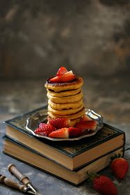 Pumpkin pancakes with maple syrup and strawberries