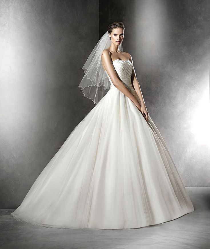 The New Design Princess wedding dress in satin and tulle. Draped satin bodice with sweetheart neckline. Voluminous skirt in plain tulle.  Free Measurement