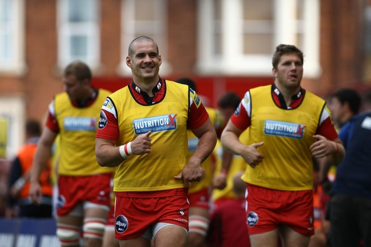 Gloucester Rugby replacements warming up against Worcester Warriors.