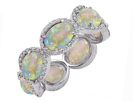 "$250 3.70ct Opal & Diamond ""Eternity Band"" in sterling silver.  I wonder if the diamonds could be replaced with little aquamarines?"