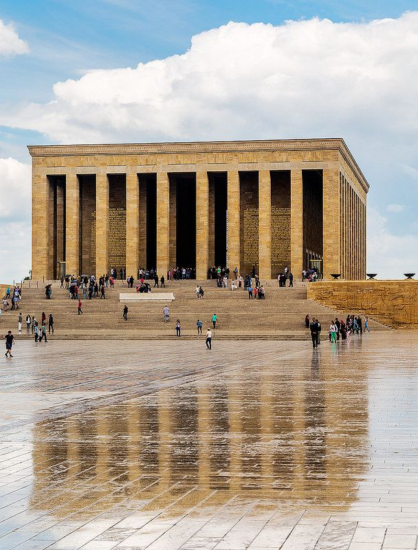 A wet floor reflects Anıtkabir in Ankara, Turkey. Anıtkabir is the mausoleum of Mustafa Kemal Atatürk, the leader of the Turkish War of Independence and the founder and first President of the Republic of Turkey. It is located in Ankara and was designed by architects Professor Emin Onat and Assistant Professor Ahmet Orhan Arda.!