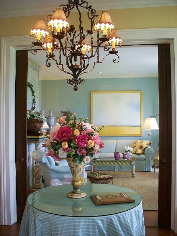 At the Mackenzie-Childs mansion.  Beautiful blue and yellow room and pink, yellow, and white flower arrangement.