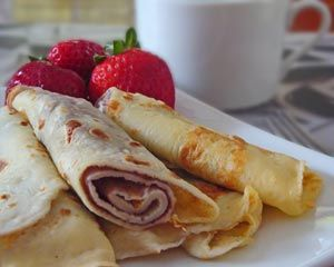 Palachinkes with strawberries: Palachinkes are also known as crepe suzettes.  When I was growing up this was one of my Dad's favourite foods.  In our tradition this recipe is used mostly
