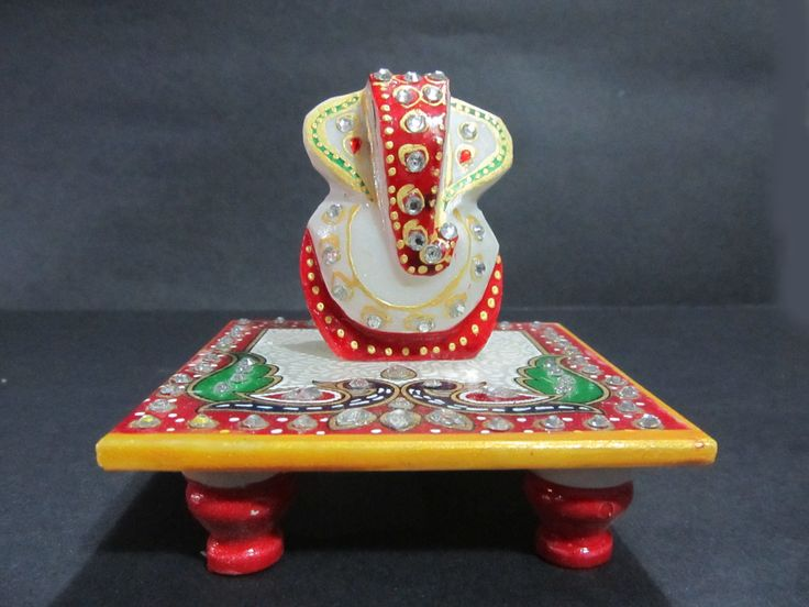 "Beautiful Marble Inlay work on Ganesha. Enhance your interiors with these beautiful pieces of delicate work . The Ganesha are made up of White Marble and finished with inlay work of semi precious stone in different colour.  all meenakari work have done.  Available size: Ganesha 2.5"" with 4""x 4"" Chowki."