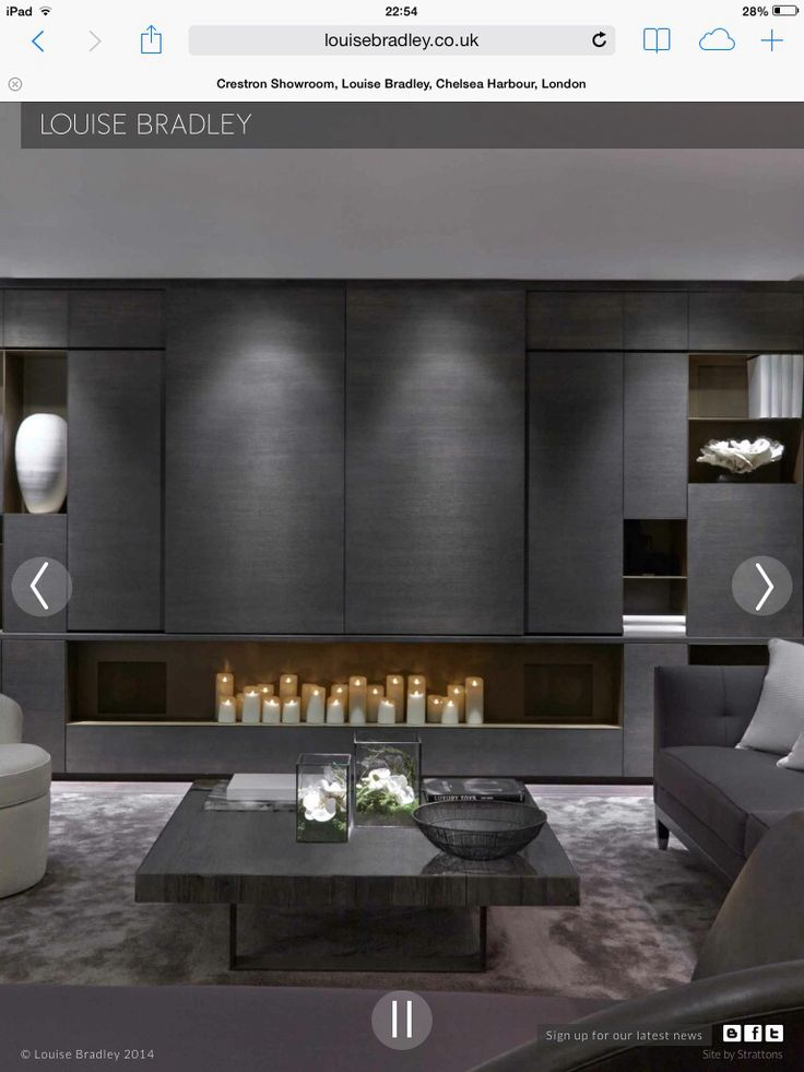 contemporary fireplace with concealed television and massed candles