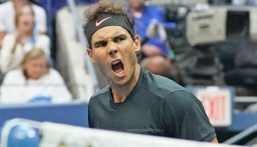 Nadal Wins 16th Grand Slam At US Open - Rafael Nadal completed a dominant US Open performance Sunday, defeating Kevin Anderson 6-3, 6-3, 6-4. Nadal caps off an extraordinary 2017 season as the No. 1 player in the world, he won the French and US Opens and made the Australian Open final against Roger Federer. Tiger Woods was in attendance for the second straight Nadal match, sitting in his box. The 31-year-old Nadal showed no signs of slowing down, dropping only one set in his last four…