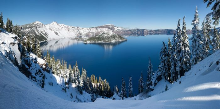 Crater Lake in the winter. Crater Lake experiences a subarctic climate, with long and very cold winters. This allows for an unbelievable amount of snowfall — sometimes averaging over 30 feet per year, with snow cover as high as 9 feet.