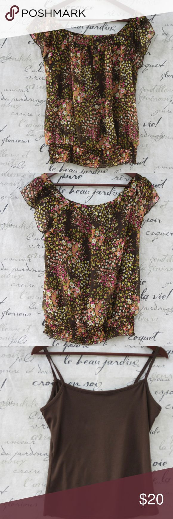 "A. Byer Brown Sheer Floral Top w/ Cami Brown with pink, white, and green flowers.  Square neckline, flutter sleeves, 4 decorative buttons in front (there is an extra one that comes with it).  The bottom is smocked.  Top comes with a brown cami.  Both are 100% polyester.  The cami is 18"" long from back to hem and 17"" across underarms.  The over blouse is 25"" long; 18"" across underarms.  EUC. A. Byer Tops Blouses"