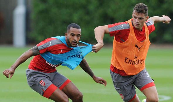 Pictures: Granit Xhaka bullies Theo Walcott during rough-and-tumble Arsenal training   via Arsenal FC - Latest news gossip and videos http://ift.tt/2aPOMrR  Arsenal FC - Latest news gossip and videos IFTTT