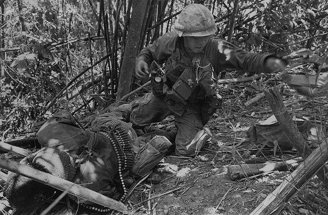 """20 May 1969, A Shau Valley, South Vietnam --- May 20, 1969 - A Shau Valley, South Vietnam: A Vietnamese rocket explodes directly behind a trooper of the 101st Airborne, wounding him seriously, during an assault on """"Hamburger Hill."""""""
