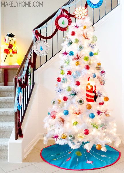 1960s Inspired White Christmas Tree via MakelyHome.com...this is just so bright and happy!  It reminds me of a Dr. Seuss book :)