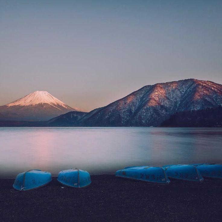 Fishing boats at dawn on Lake Motosuko.  #canonjapan #canonjapan #natgeoyourshot