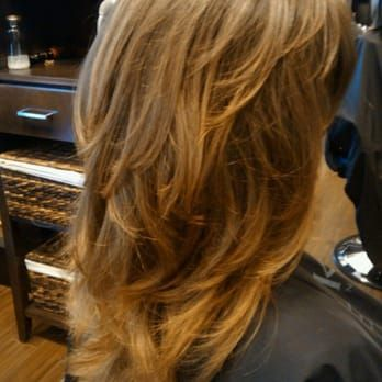 Tons on layers to emphasize natural wave...Hair by Danielle E - Yelp