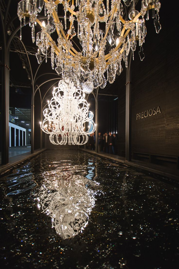 They reflected on the watery surface and in the excited eyes of design, light, and crystal lovers. #chandeliers #euroluce2015 #milandesignweek #salonedelmobile #reflections #light #design #interiordesign #crystal #glass #craftsmanship #preciosalighting