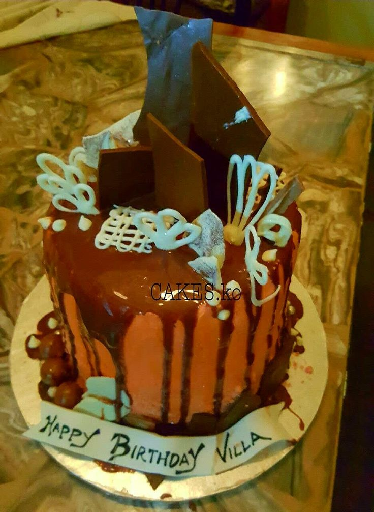 All chocolate drip cake. Click link to my business page for more of my work.