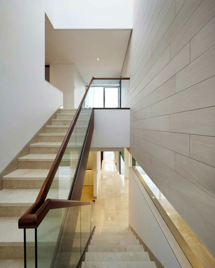Architecture, Modern Staircase Design With White Interior Decorating Ideas Marble Flooring Tile Glass Railings And Wood Banister: The Stunning Private Houses Seongbuk Gate Hills Located in Seoul South Korea