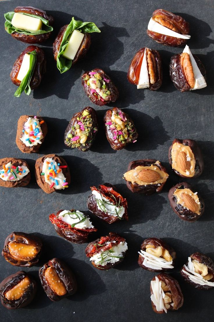 [Stuffed Dates 8 Ways] Left to right: 1) fontina with basil, 2) brie with pecan, 3) tiramisu, 4) baklava, 5) peanut butter almond, 6) chocolate pretzel, 7) basil, sun-dried tomato goat cheese, 8) coconut walnut.  Visit the link for easy-to-follow instructions.