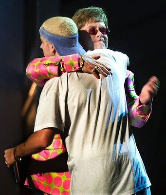 Elton John hugs rap singer Eminem after they performed the song Stan at the Grammys in 2001.
