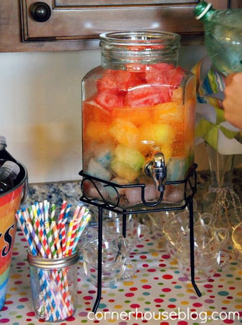Rainbow punch (colored ice cubes with 7-up poured over them.  Would be cute done in wedding colors.