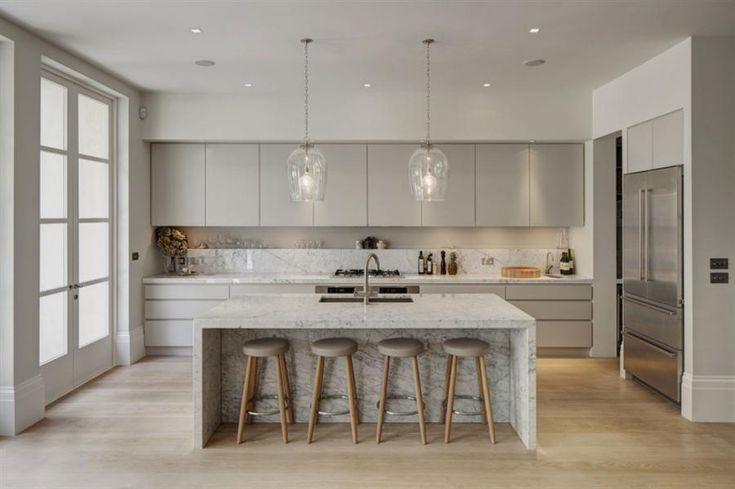 elegant kitchen supplemented by gray overhead cabinet, soft grey kitchen cabinet, , kitchen table with four bar stools and glass pendant lamps. This is my favourite kitchen.....
