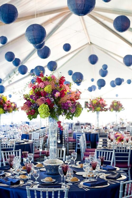 Totally digging the tall arrangements and the dark blue paper lanterns in this tent wedding.