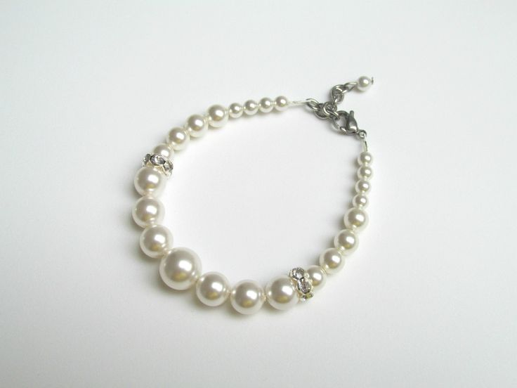 Bracelet made of Swarovski Pearls with silver plated rhinestones Can be ordered here: https://www.facebook.com/handmadebutic