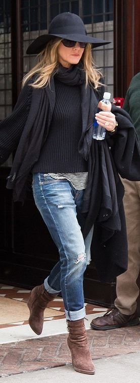 Who made Jennifer Aniston's wedge boots, black handbag, sunglasses, and ripped blue jeans?