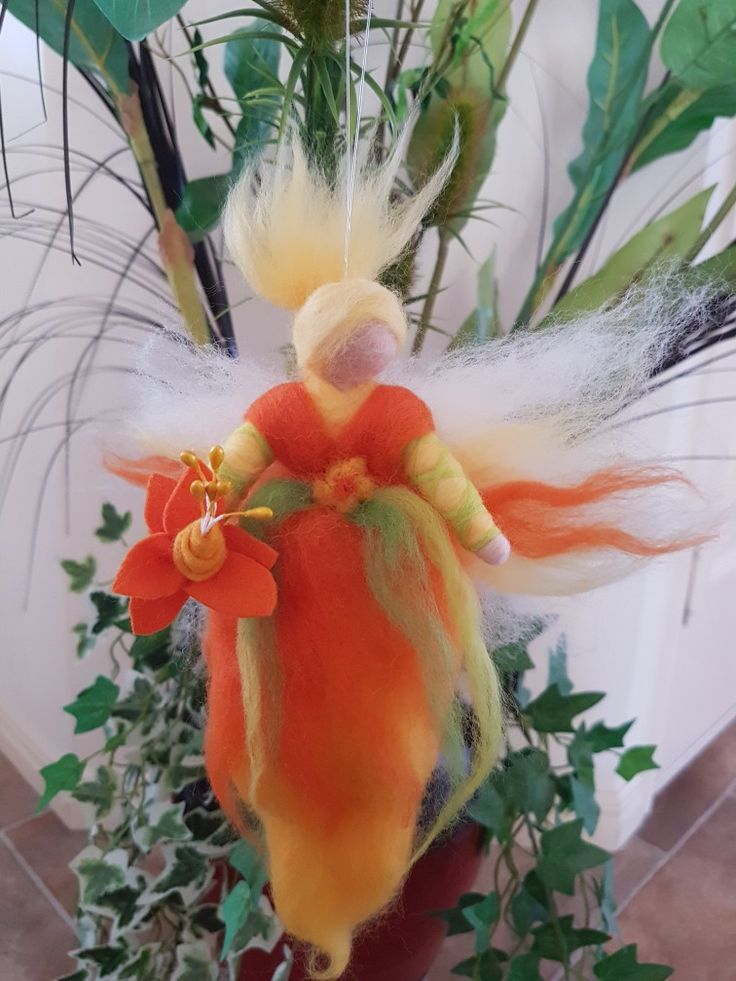 Steiner inspired Flower Fairy.  Body length is roughly 20cm.  Wire armature for arms so they can be positioned however you would like. Made from merino tops. Flower is made primarily from felt.