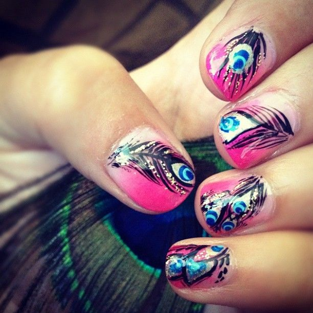 Peacock Feather Nail Art with a pink ombre radiant background.