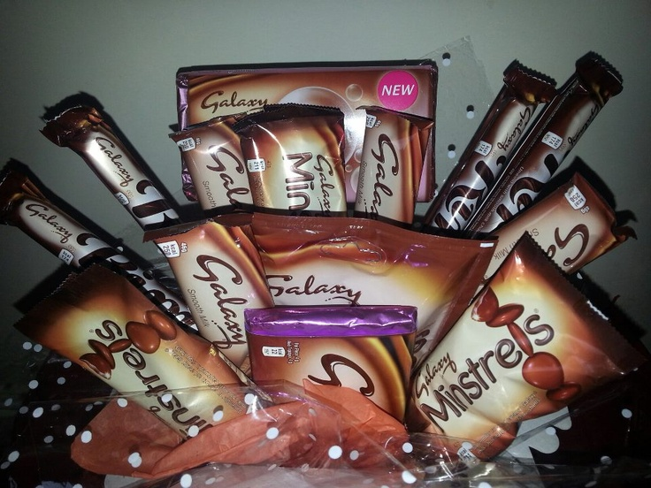 Galaxy chocolate bouquet. 4 ripples 4 galaxy bars 3 packs of minstrels 1 share packet of caramel bites 1 share size bar of bubbles galaxy 1 share size bar of cookie crumble. Perfect for that sunday night in.