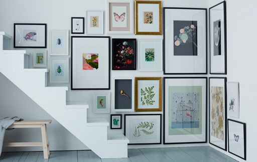 ** How-to Hang Pictures in Awkward Spaces ** (Ikea.com)   -- LOVE this Set-up!!... Focal Point is Based on Main Level of House VS Picture Frames that are Climbing-up the Wall w/ Each Stair!!...   -- Direct Link to Full Article = http://www.ikea.com/us/en/ideas/201721_idde07a/   -- ALL How-to's -&- Ikea Idea's = http://www.ikea.com/us/en/ideas/