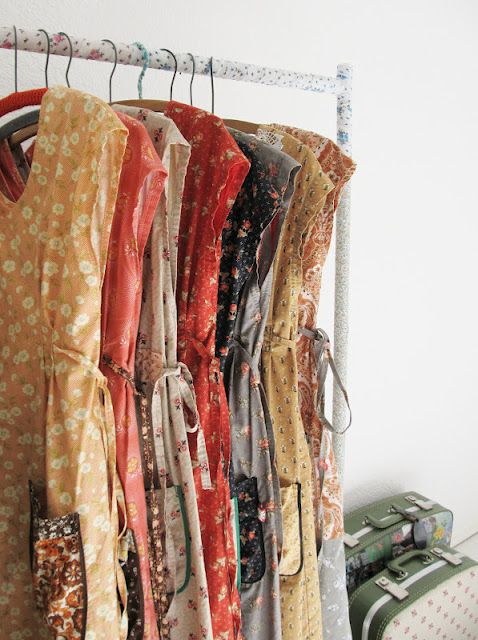 this is what i want my closet to look like- except i need sleeves or smaller arms. and i'm going to call them frocks- so there!
