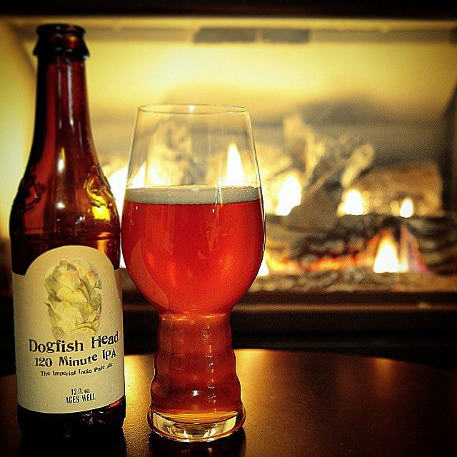 Dogfish Head 120 Minute IPA, an IPA glass and a toasty warm log fire. Great shot from @max_power_90 #winter #craftbeer #IPA #beer #dogfishhead