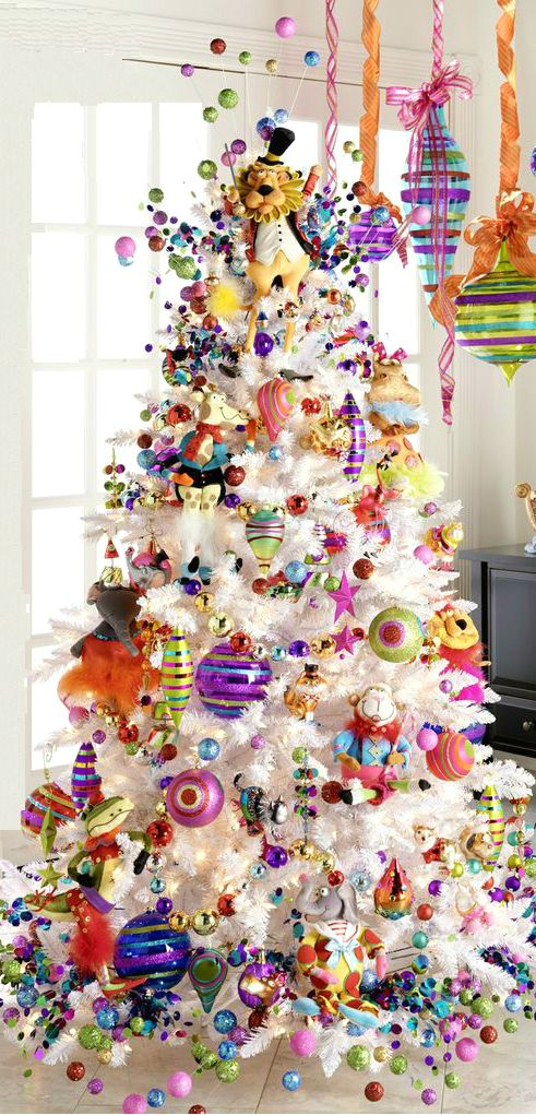 """Using pink, purple and other fun non-traditional colors just says, """"Merry Christmas"""". I love these colors on a white tree background. A few strands of pink or purple mini lights would set off the bulbs nicely."""