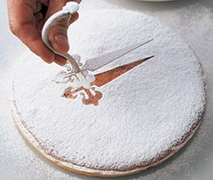 Tarta de Santiago...a Spanish almond cake named for the Apostle Saint James (Santiago).  The cake is covered with powdered sugar and marked with the cross of the knights of St. James.
