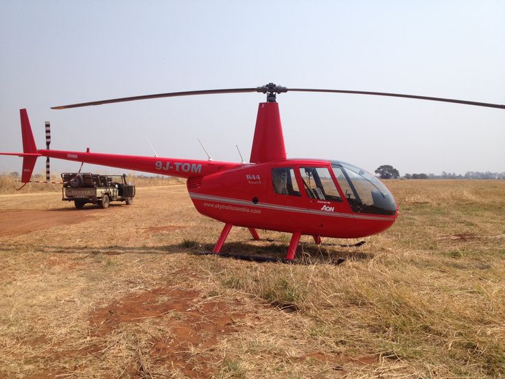Helicopter landing at the Lilayi air strip, guests being fetched by the land cruiser and taken to the resort