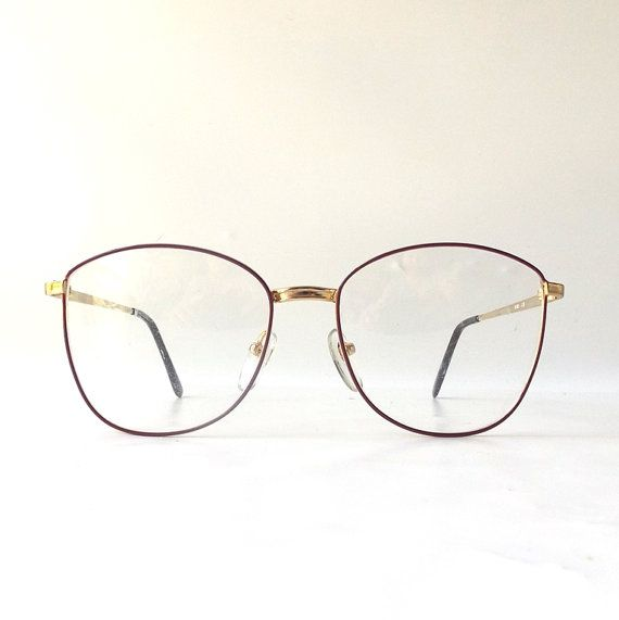 vintage 1980s retro modern new old stock fashion eyeglasses -- round oversized red wine colored enamel frames with gold metal arms -- these