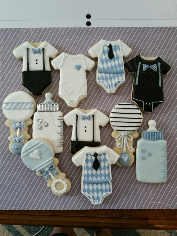 This Listing is for 1 Dozen, Delicious little man cookies for baby shower or your little mans birthday party. Each cookie is hand rolled to order and hand cut. These cookies are decorated with Royal Icing, metallic dust and edible markers. Please note that this is a handmade item and no two cookies are exactly alike, as much as I try to make them the exact same, minor variations are normal and should be expected. Our cookies are made with the finest ingredients: - Buttery sugar cookies…