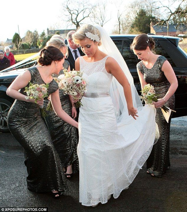 Helen Skelton of Blue Peter fame married in 2013: Helen's three bridesmaids helped to straighten out her dress as she prepared to make her way into the church